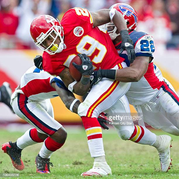 Kansas City Chiefs safety Eric Berry is brought down by Buffalo Bills wide receiver Roscoe Parrish and running back Fred Jackson after intercepting a...