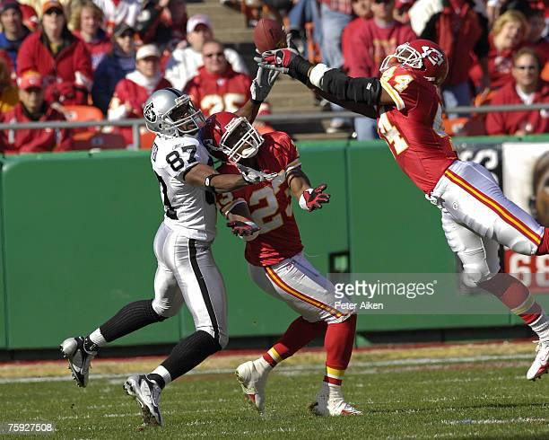 Kansas City Chiefs safety Jarrad Page bats the pass away for Oakland wide receiver Alvis Whitted as Chiefs Patrick Surtain helps defend on the play...