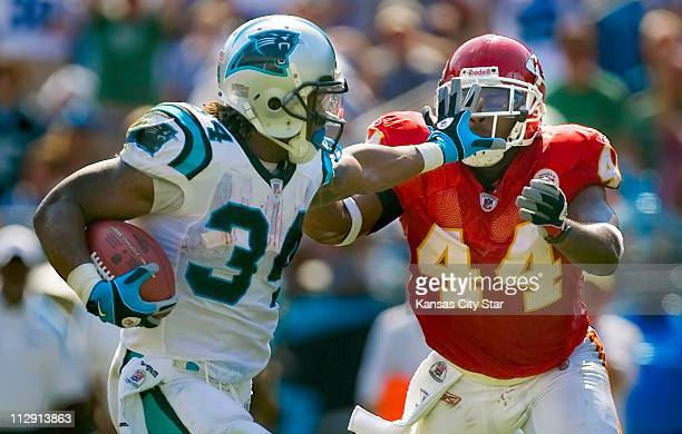 Kansas City Chiefs safety Jarrad Page right was pushed away by Carolina Panthers running back DeAngelo Williams left on a 32yard touchdown run in the...