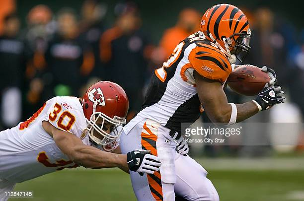 Kansas City Chiefs safety Mike Brown left tackles Cincinnati Bengals running back Cedrick Benson right during game action The Bengals defeated the...