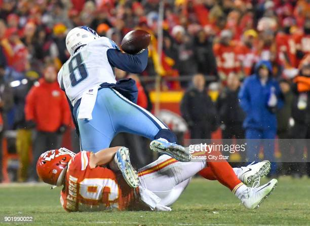 Kansas City Chiefs strong safety Daniel Sorensen tackles as Tennessee Titans quarterback Marcus Mariota appears to fumble the ball on a twopoint...
