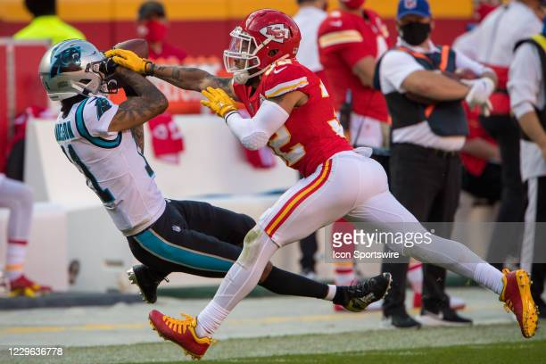 Kansas City Chiefs strong safety Tyrann Mathieu tries to tackle Carolina Panthers wide receiver Robby Anderson at Arrowhead Stadium in Kansas City,...