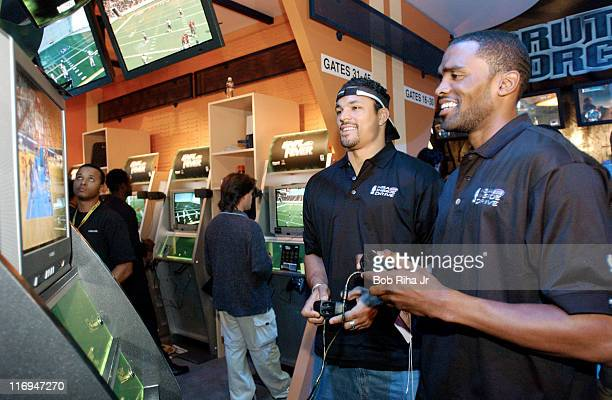 "Kansas City Chiefs tight end Tony Gonzalez challenges Houston Rockets Cuttino Mobley to a game of Microsoft's ""NBA Inside Drive 2003"" at the Xbox..."