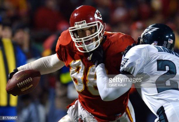 Kansas City Chiefs tight end Tony Gonzalez is brought down by Philadelphia Eagles free safety Brian Dawkings during the third quarter of the Eagles...