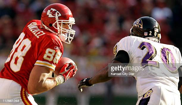 Kansas City Chiefs tight end Tony Gonzalez prepares to clash with Baltimore Ravens safety Ed Reed during third quarter action The Ravens defeated the...