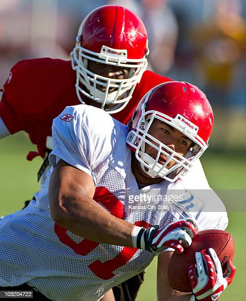 Kansas City Chiefs tight end Tony Moeaki hauls in a pass in front of Chiefs linebacker David herron during training camp at Missouri Western State...