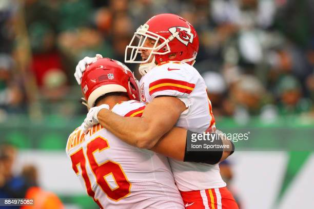 Kansas City Chiefs tight end Travis Kelce celebrates with teammate Kansas City Chiefs offensive guard Laurent DuvernayTardif after he scores his...