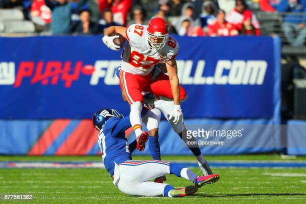 Kansas City Chiefs tight end Travis Kelce hurdles New York Giants free safety Darian Thompson during the first quarter of the National Football...