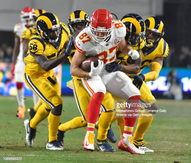 Kansas City Chiefs tight end Travis Kelce is tackled by a group of Rams defenders at the Los Angeles Memorial Coliseum on Monday Nov 19 2018