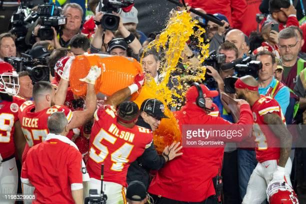 Kansas City Chiefs Tight End Travis Kelce Kansas City Chiefs Linebacker Damien Wilson and Kansas City Chiefs Offensive Tackle Cam Erving pour...