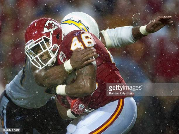 Kansas City Chiefs Tim Castille is stopped by San Diego Chargers linebacker Stephen Cooper in the third quarter at Arrowhead Stadium in Kansas City,...