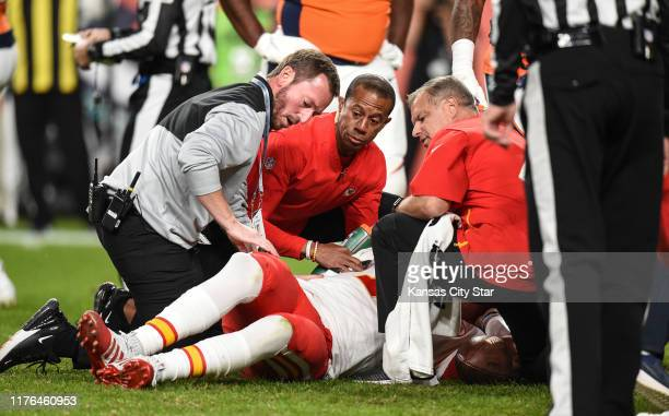 Kansas City Chiefs trainers attend to quarterback Patrick Mahomes after he injured his knee in the second quarter against the Denver Broncos on...