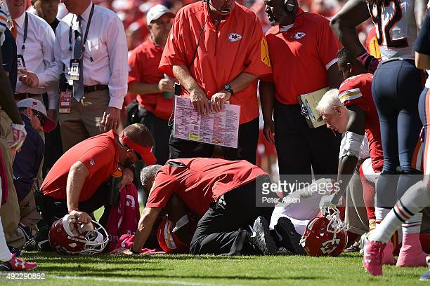 Kansas City Chiefs training staff attends to an injury for Jamaal Charles of the Kansas City Chiefs after a run with head coach Andy Reid of the...