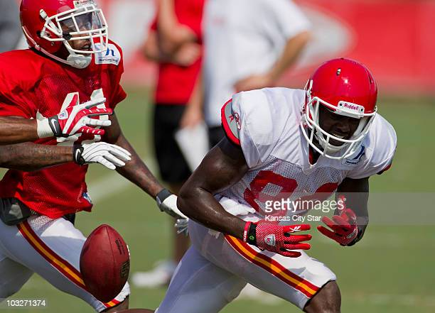 Kansas City Chiefs wide receiver Chris Chambers let a pass slip through his hands during practice at the team's summer training camp at Missouri...