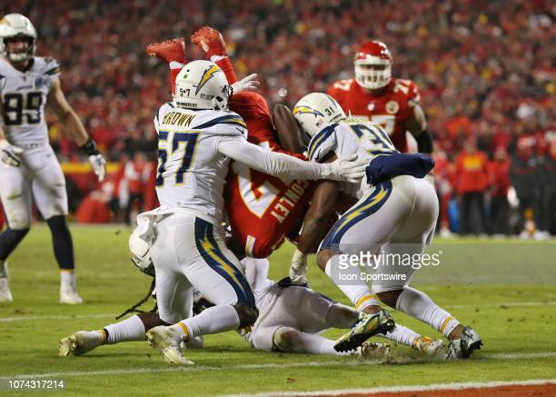 Kansas City Chiefs wide receiver Chris Conley goes upside down after being tackled by Los Angeles Chargers outside linebacker Jatavis Brown and...