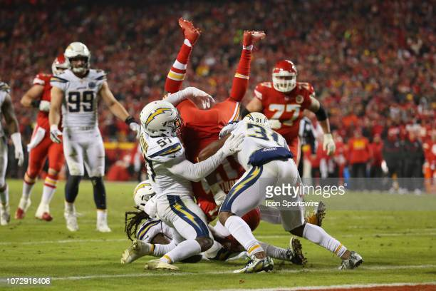 Kansas City Chiefs wide receiver Chris Conley goes upsides after being tackled by Los Angeles Chargers outside linebacker Jatavis Brown and defensive...