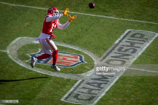 Kansas City Chiefs wide receiver Demarcus Robinson catches a pass during warms over the AFC Championship logo on the field prior to the AFC...