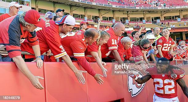 Kansas City Chiefs wide receiver Dexter McCluster is congratulated by fans at the end of the game against the New York Giants at Arrowhead Stadium in...