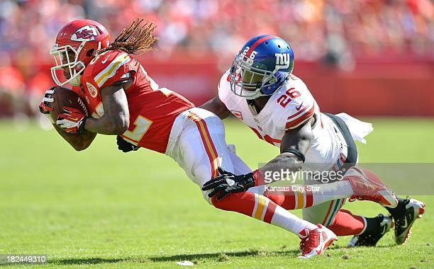 Kansas City Chiefs wide receiver Dexter McCluster picks up a first down before being stopped by New York Giants strong safety Antrel Rolle during the...