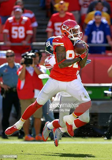 Kansas City Chiefs wide receiver Dwayne Bowe catches a touchdown pass in front of New York Giants defensive back Terrell Thomas in the fourth quarter...