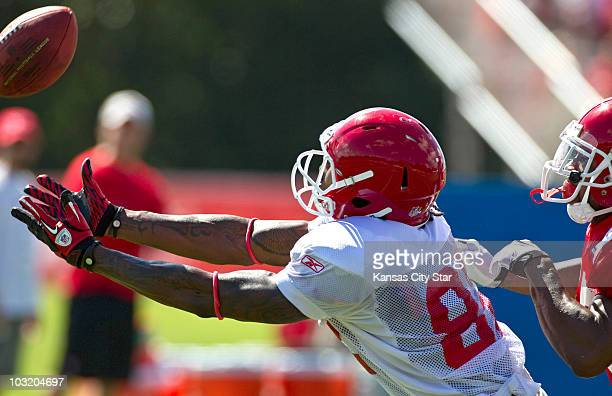 Kansas City Chiefs wide receiver Dwayne Bowe is just short of reaching a pass in front of safety Ricky Price during training camp at Missouri Western...