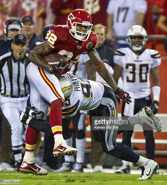 Kansas City Chiefs wide receiver Dwayne Bowe is stopped by San Diego Chargers linebacker Shaun Phillips on a pass in the third quarter at Arrowhead...