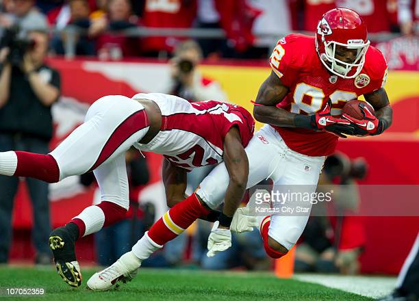 Kansas City Chiefs wide receiver Dwayne Bowe right caught a oneyard touchdown pass against Arizona Cardinals cornerback Dominque RodgersCromartie...
