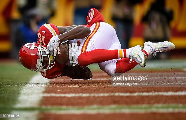 Kansas City Chiefs wide receiver Jeremy Maclin catches an 11yard touchdown pass during the first quarter on Sunday Dec 27 at Arrowhead Stadium in...