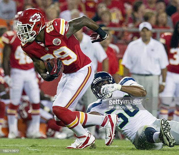 Kansas City Chiefs wide receiver Jon Baldwin pulls away from Seattle Seahawks linebacker KJ Wright in the second quarter for a first down in NFL...