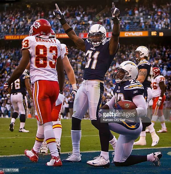 Kansas City Chiefs wide receiver Mark Bradley left walked off the field as San Diego Chargers cornerback Antonio Cromartie celebrated with teammate...