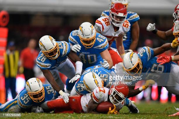 Kansas City Chiefs wide receiver Mecole Hardman is tackled by Los Angeles Charger players during the 2019 NFL week 11 regular season football game...