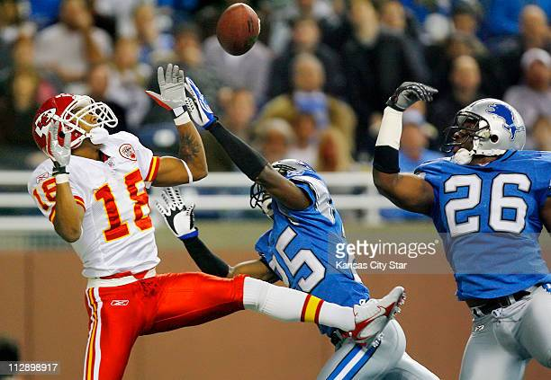 Kansas City Chiefs wide receiver Samie Parker has a pass to the end zone tipped away by Detroit Lions cornerback Fernando Bryant and safety Kenoy...