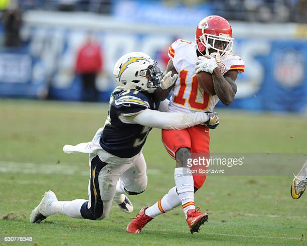 Kansas City Chiefs Wide Receiver Tyreek Hill tries to get away from San Diego Chargers Linebacker Jatavis Brown during the NFL Football game between...