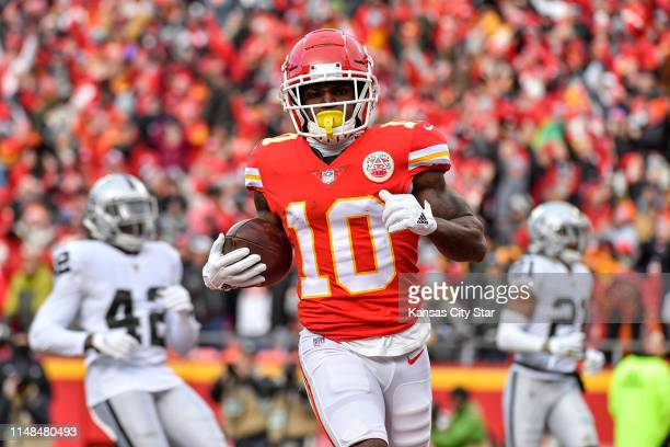 Kansas City Chiefs wide receiver Tyreek Hill trots into the end zone to score against the Oakland Raiders on Dec 30 2018 at Arrowhead Stadium in...