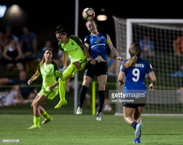 Kansas City Defender Becky Sauerbrunn and Seattle Reign Forward Nahomi Kawasumi jump for a header during the NWSL match between FC Kansas City and...