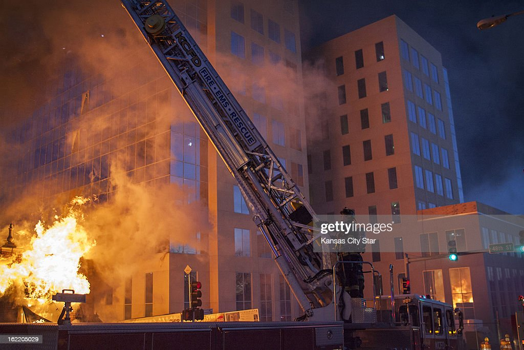 Kansas City firefighters work the scene of an explosion and 4-alarm fire at JJ's restaurant on The Country Club Plaza, in Kansas, City, Tuesday, February 19, 2013.