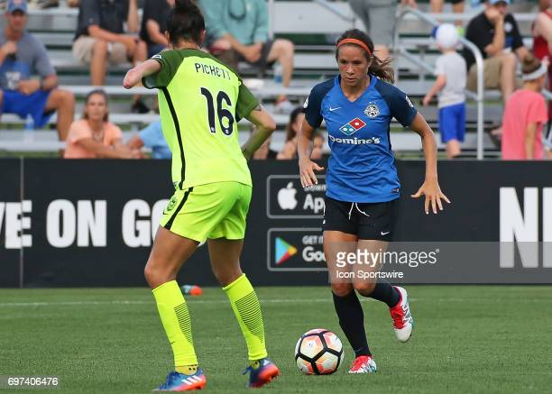 Kansas City forward Shea Groom works on Seattle Reign FC defender Carson Pickett in the first half of an NWSL match between the Seattle Reign FC and...