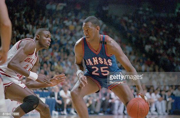 Kansas City: Kansas' Danny Manning drives on Oklahoma's Harvey Grant during 1st half action in their NCAA Championship game in Kansas City.