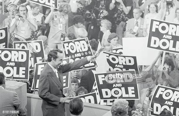 Senator Robert Dole of Kansas Ford's vicepresidential choice waves to standing ovation before delivering his acceptance speech at the closing session...