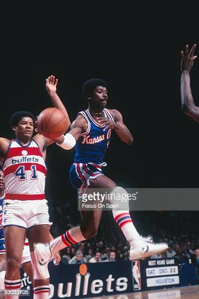 Kansas City Kings' Phil Ford abandons a layup and passes against the Washington Bullets during a game at Capital Centre circa 1979 in Washington,...