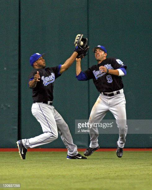 Kansas City left fielder Emil Brown makes the catch just before colliding with center fielder David DeJesus during Sunday's game against Tampa Bay at...