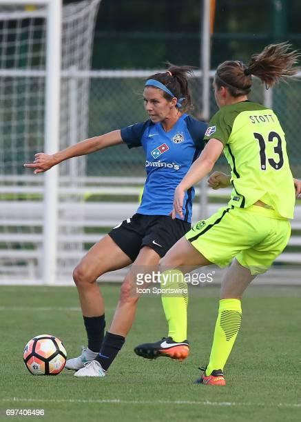 Kansas City midfielder Erika Tymrak kicks the ball past Seattle Reign FC defender Rebekah Stott in the first half of an NWSL match between the...
