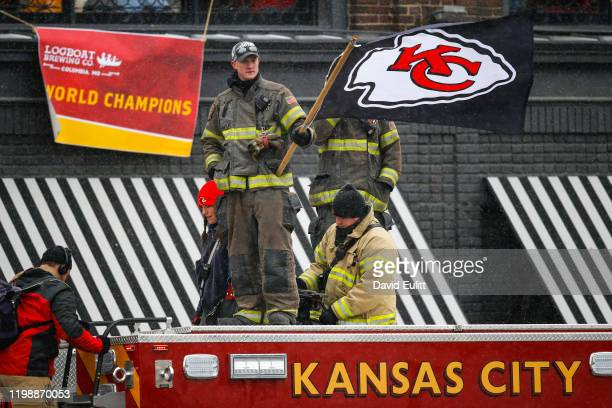 Kansas City Missouri firefighter waves a Kansas City Chiefs flag atop one of the citys fire engines on February 5 2020 in Kansas City Missouri during...