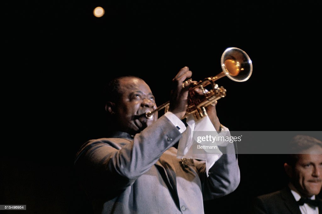 Louis Armstrong Playing Trumpet in Concert : News Photo