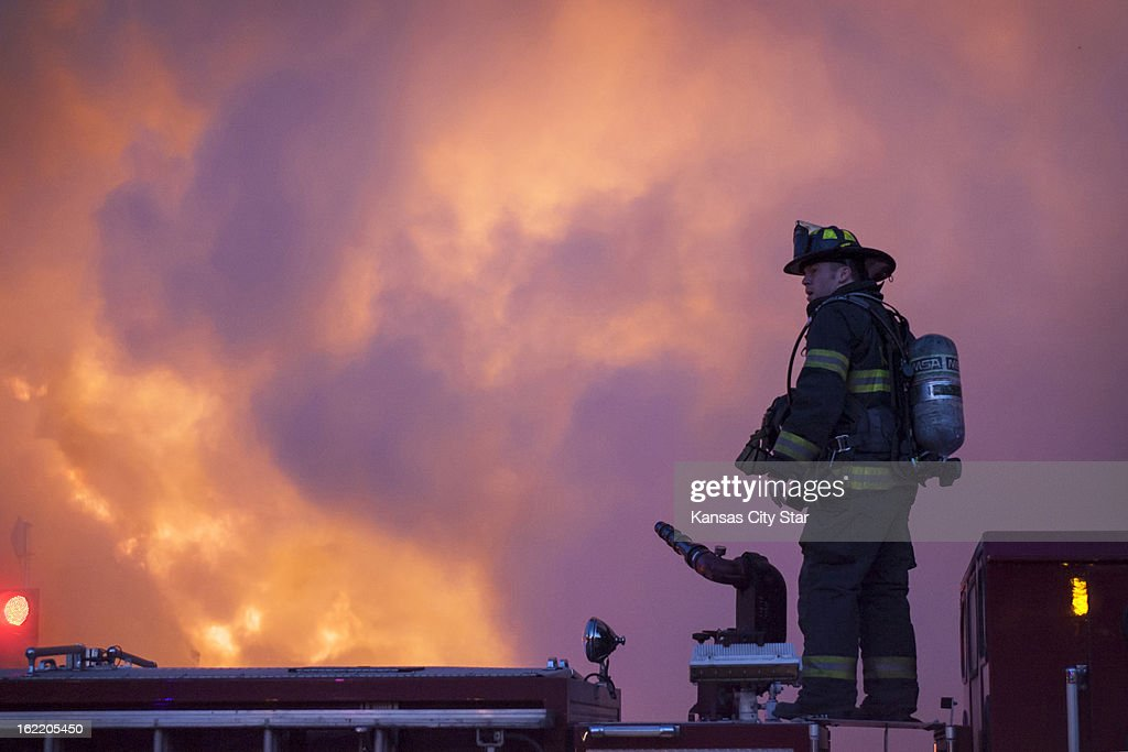 Kansas City, Mo., firefighters work the scene of an explosion and 4-alarm fire at JJ's restaurant on The Country Club Plaza, in Kansas, City, Tuesday, February 19, 2013.