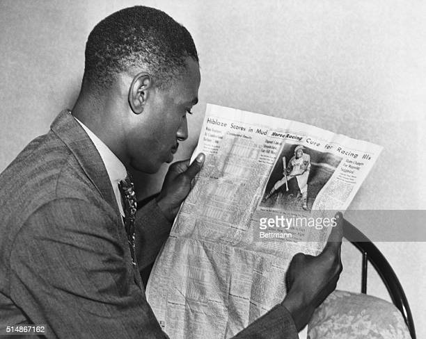 Kansas City Monarchs pitcher Satchel Paige reads the sports page in Washington, D.C. His team is in town to play the Homestead Grays, another Negro...