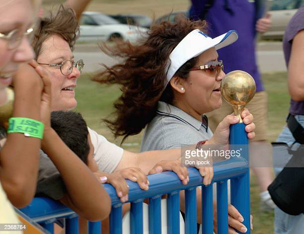 Kansas City Parks Commssioner CiCi Rojas wearing white visor background teams up with unidentified children during the Nickelodeon Bed Relay at the...