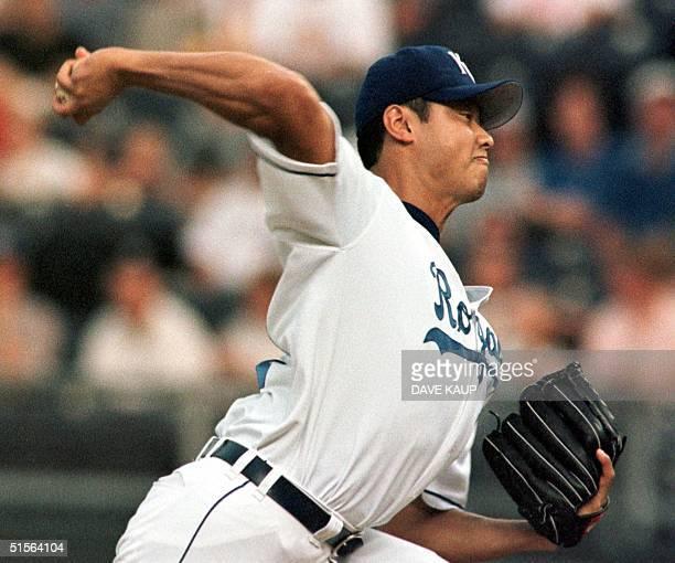 Kansas City Royal starting pitcher Mac Suzuki fires a pitch to New York Yankee Jorge Posada Labor Day 04 September 2000 at Kauffman Stadium in Kansas...