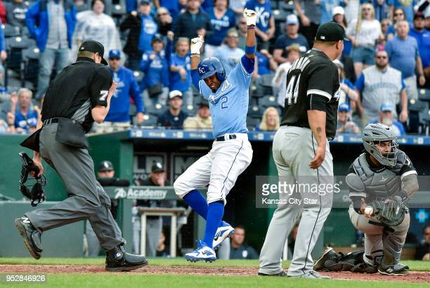 Kansas City Royals' Alcides Escobar scores in the eighth inning behind Chicago White Sox catcher Omar Narvaez and relief pitcher Bruce Rondon on a...