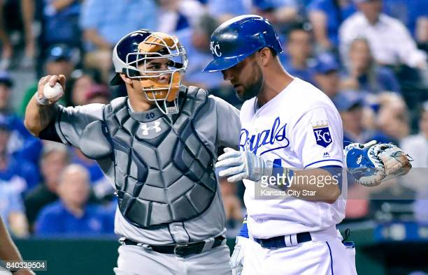 Kansas City Royals' Alex Gordon heads to the dugout as Tampa Bay Rays catcher Wilson Ramos sends the ball back to the mound after Gordon struck out...